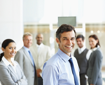 Smiling: Group of satisfied business people